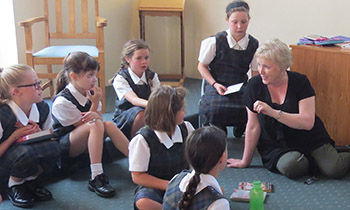 Marsden Primary Director Celia McCarthy helps Y6 students make 'positive' cards