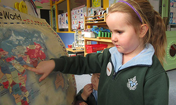 Marsden preschool students point out their origins on a world map